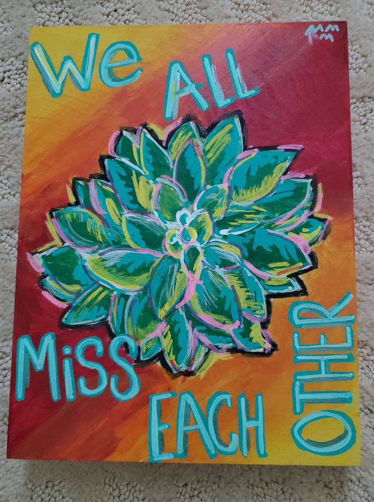"Green flower on orange background with text ""we all miss each other"""